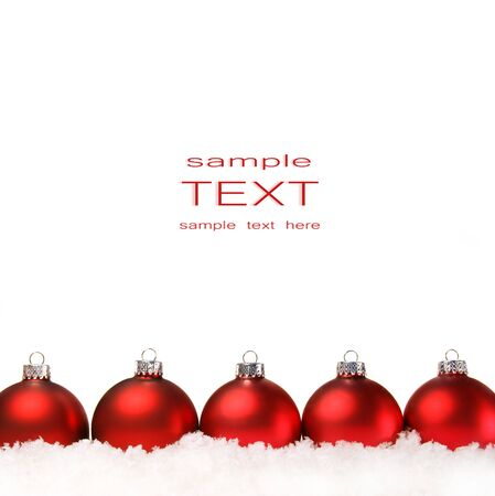 christmas backgrounds: Red christmas balls with snow isolated on white background Stock Photo