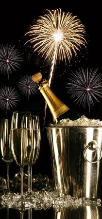 Glasses of champagne with fireworks on black background photo