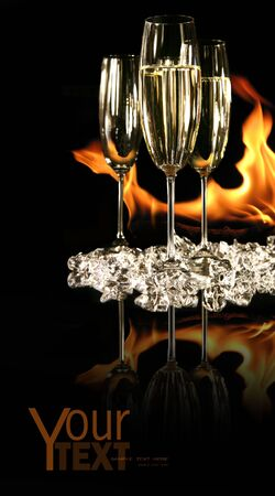 Glasses of champagne with ice and fire on black Stock Photo - 3899325