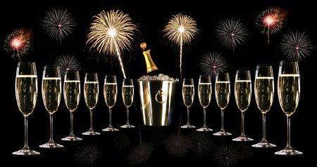 Glasses of champagne with silver ice bucket and fireworks photo