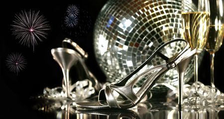 Silver party shoes with champagne glasses against a party background