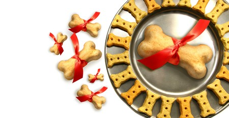 Doggy biscuits for christmas against white background photo