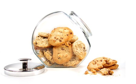 Homemade cookies in glass jar on white background photo