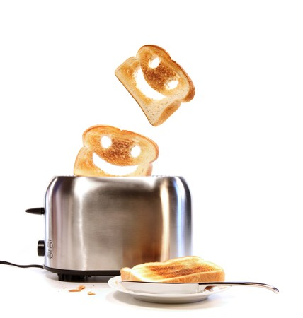 Toasted bread with toaster on white background photo