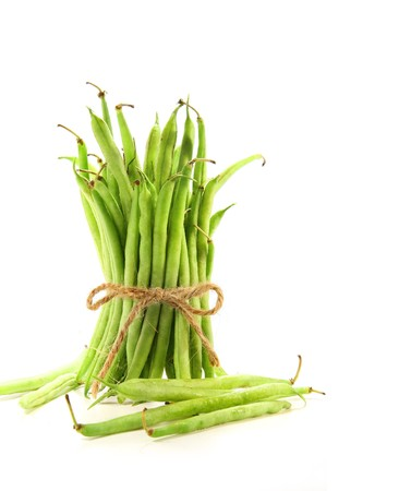 snap bean: Unwashed green beans tied with cord on white background Stock Photo
