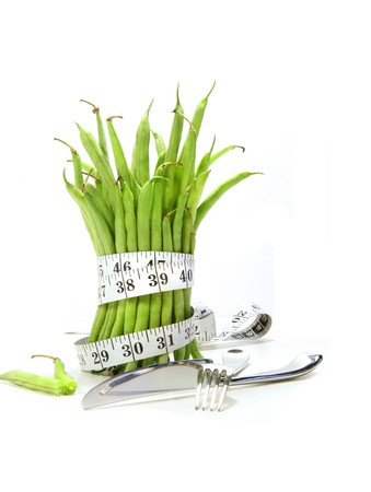 Unwashed green beans with cord and utensils on white Stock Photo - 4186255