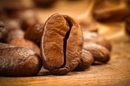 Closeup shot of a coffee bean on wood Stock Photo - 4264074