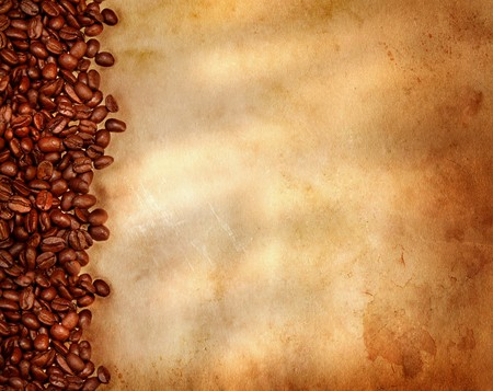 rusty background: Coffee beans on old parchment paper