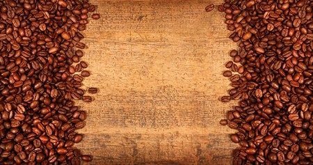 Roasted coffee beans on rustic wood background