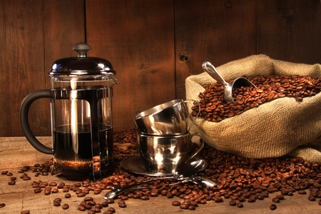Sack of coffee beans with french press and cups photo