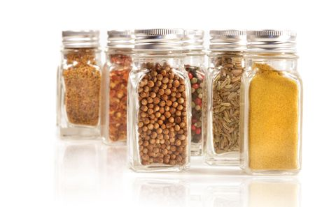Assorted spice jars isolated on white background photo