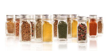 Assorted spice bottles isolated on white background photo