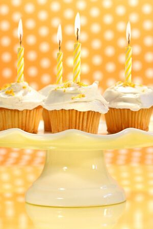 Cupcakes with orange zest sprinkled on top with polka dot background photo