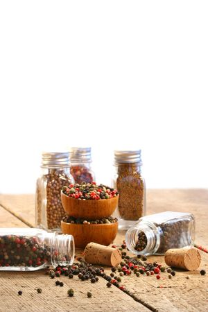 Spice bottles on rustic table with white background Stock Photo - 4717589