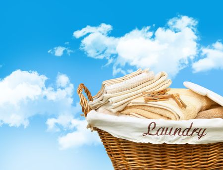 laundry: Laundry basket with towels against a blue sky