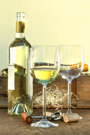 Still life of white wine bottle and glasses with crate in background Stock Photo - 5470805