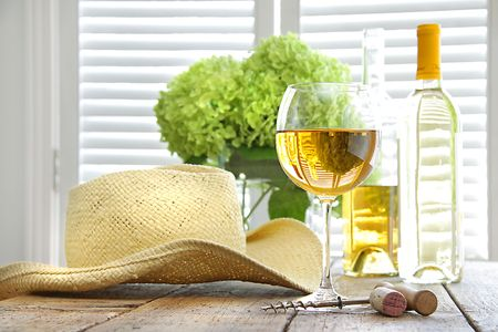 Glass of wine with straw hat on table Stock Photo - 5536743