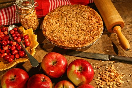 Crumble pie with apples and cranberries for fall baking photo