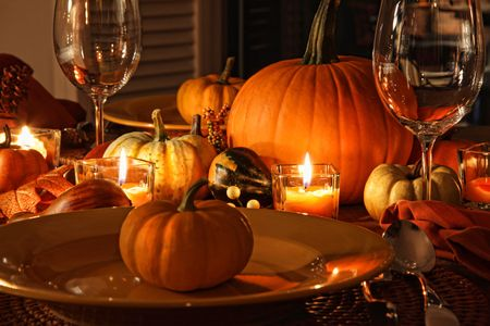 thanksgiving dinner: Festive autumn place settings with pumpkins and candles Stock Photo