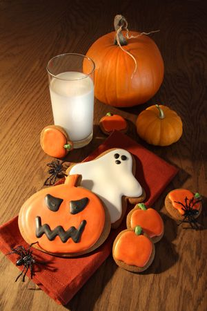 Halloween cookies with pumpkins and a glass of milk Stock Photo - 5630763