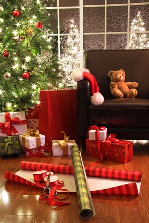 christmas gift: Christmas tree with gifts and teddy bear on chair
