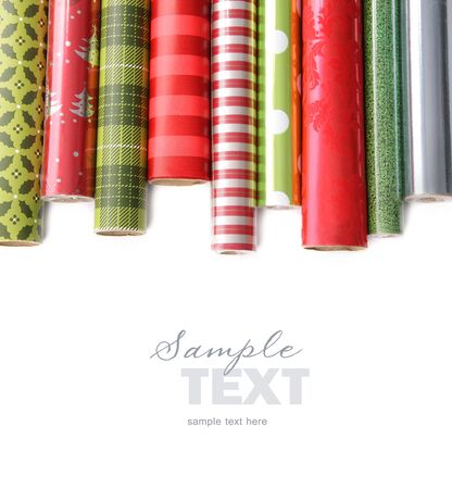 christmas wrapping paper: Rolls of colored wrapping  paper on white background Stock Photo