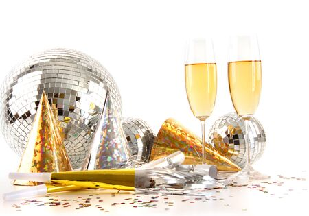 Champagne glasses with gold party hats and big disco ball photo