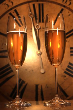 Champagne glasses ready to bring in the New Year with clock  Stock Photo - 6122469