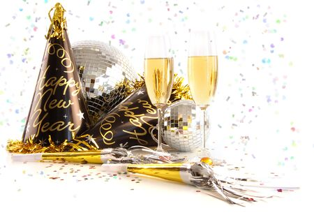 new years day: Champagne glasses with festive party hats on white background Stock Photo