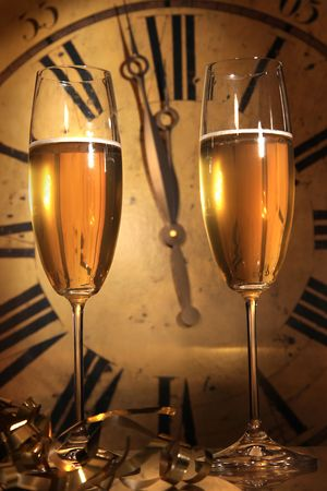 hour glasses:  Glasses of Champagne ready to bring in the New Year