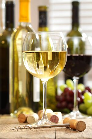 Glasses of wine with bottles in background Stock Photo - 6242857