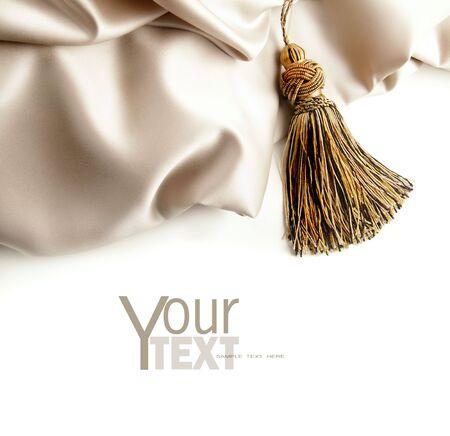 tassels: Fabric satin texture on white background