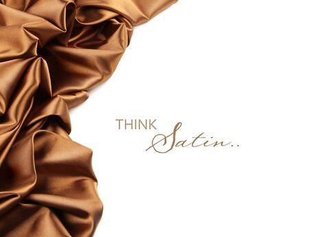 Rich golden brown satin fabric on white background