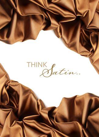 Rich golden brown satin fabric on white background photo