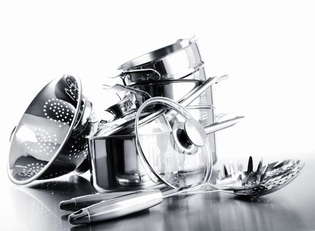 stainless steel pot: Pile of pots and pans against a white background