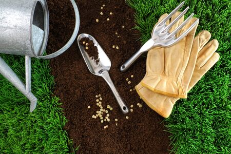 Assortment of garden tools with earth and grass Stock Photo - 7000064