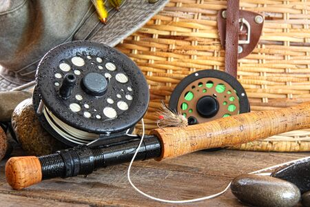 fishing bait: Close-up fly fishing rod with equipment