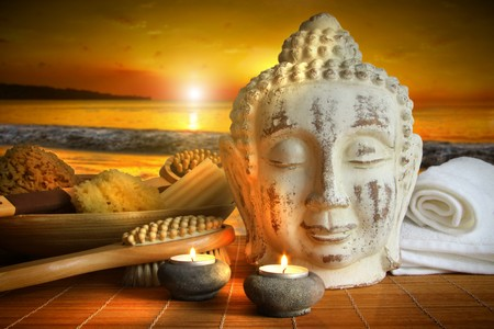 Bath accessories, candles with buddha statue at sunset photo