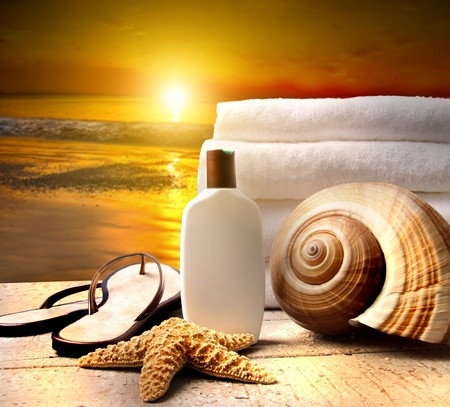 Beach accessories with a golden sunset photo