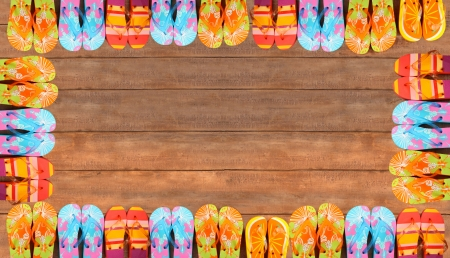 thongs: Brightly colored flip-flops on wood deck