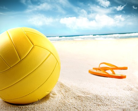 Volleyball in the sand with sandals at the beach Stock Photo - 7227063