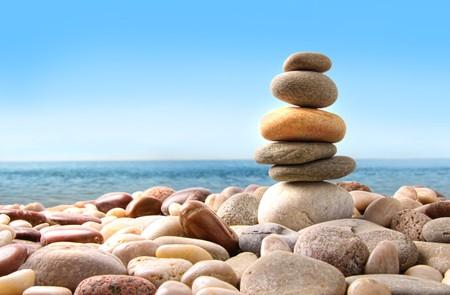 Stack of pebble stones on white background Stock Photo