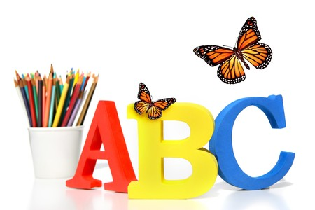 grammar: ABC letters with pencils on white background
