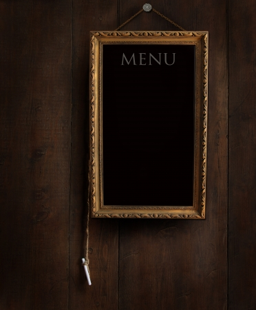 menu: Old chalkboard on wood with copy space for writing menu