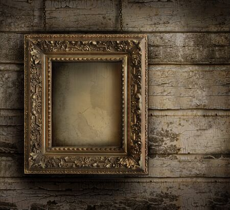Old frame against a grungy, peeling painted wall