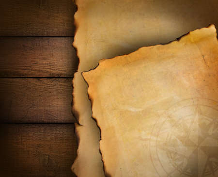 Closeup of parchment papers on wood background photo