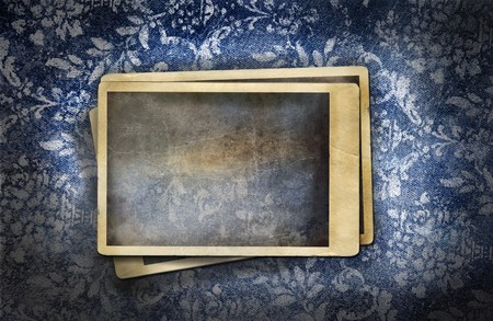 Grungy denim with photos on faded floral background
