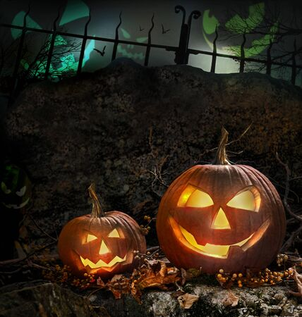 halloween background: Halloween pumpkins on rocks in a forest at night