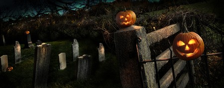Two Halloween pumpkins sitting on a fence Stock Photo - 8042546