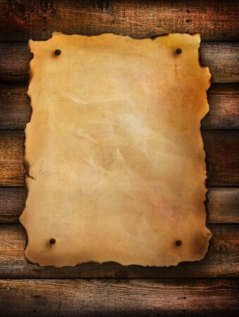 wood texture background: Vintage paper on distressed wood background